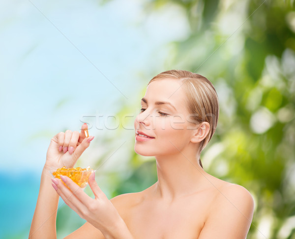 lovely woman with omega 3 vitamins Stock photo © dolgachov