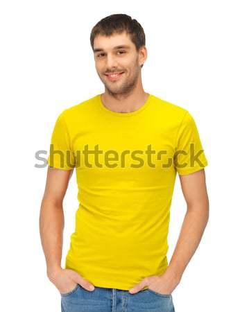Knappe man Geel shirt kleding ontwerp mensen Stockfoto © dolgachov