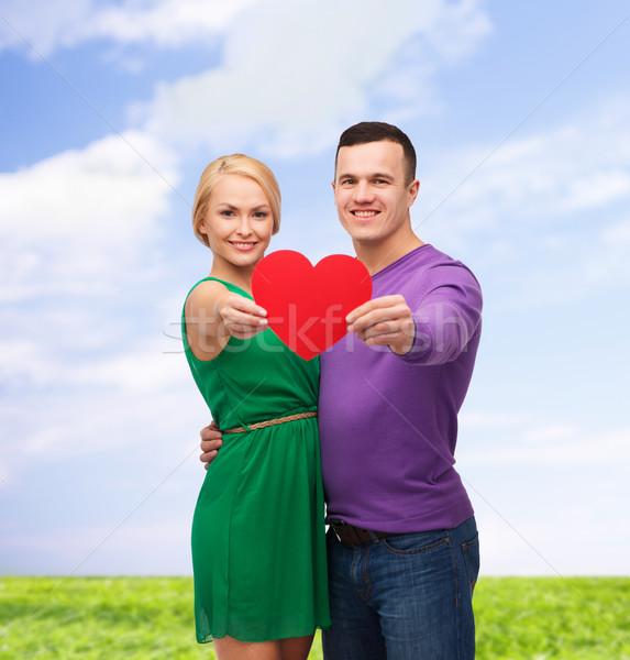 smiling couple holding big red heart Stock photo © dolgachov