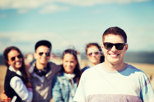 teenager in shades outside with friends Stock photo © dolgachov
