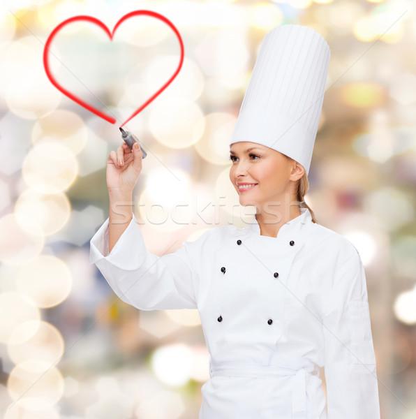 Sonriendo femenino chef dibujo rojo corazón Foto stock © dolgachov