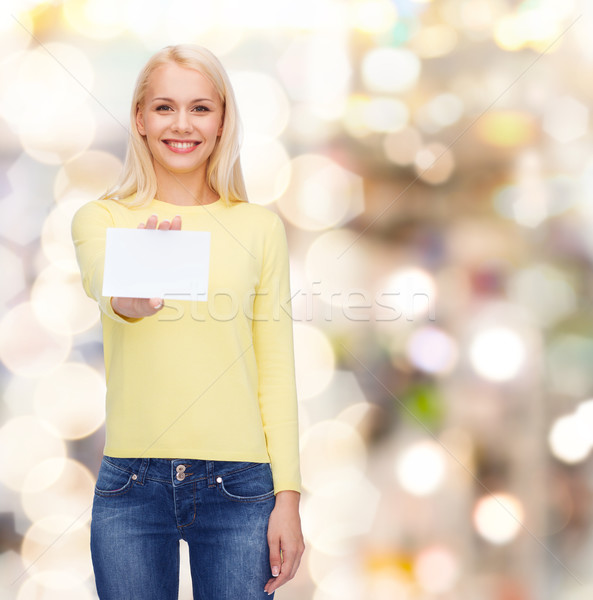 smiling girl with blank business or name card Stock photo © dolgachov