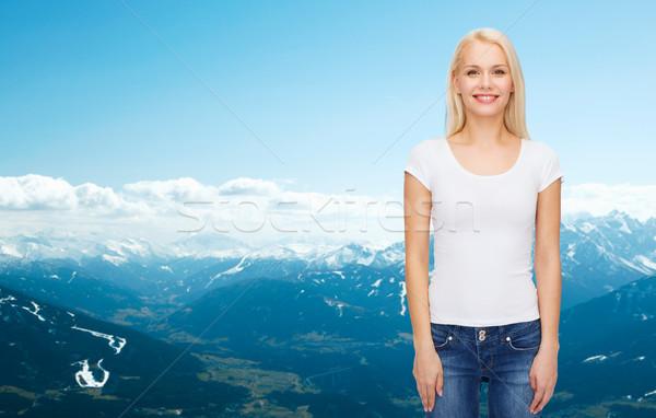 Uśmiechnięta kobieta biały tshirt projektu uśmiech szczęśliwy Zdjęcia stock © dolgachov