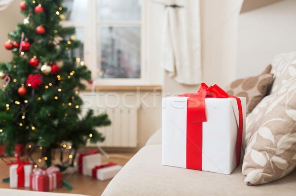gift box on coach at home Stock photo © dolgachov