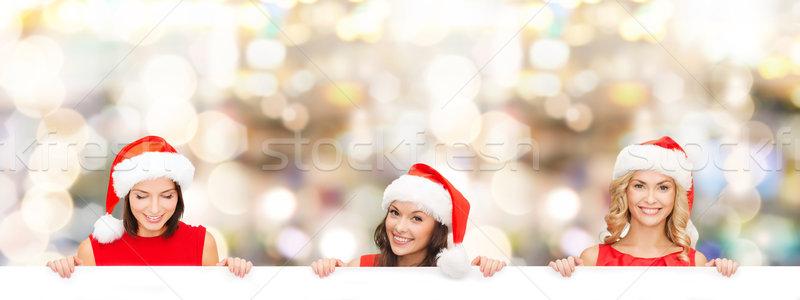 Kadın yardımcı şapka beyaz tahta Noel Stok fotoğraf © dolgachov