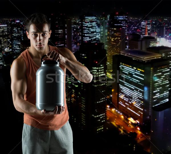 Genç erkek vücut geliştirmeci kavanoz protein Stok fotoğraf © dolgachov