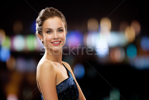 Gülümseyen kadın gece elbisesi tatil insanlar gece şehir ışıkları Stok fotoğraf © dolgachov
