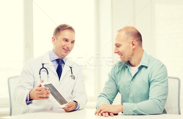 doctor with tablet pc and patient in hospital Stock photo © dolgachov
