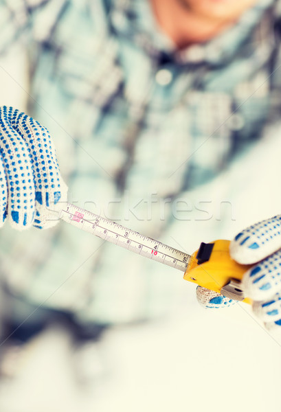 architect measuring wall with flexible ruler Stock photo © dolgachov