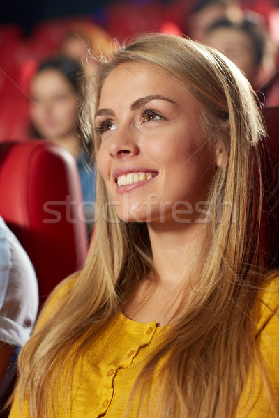 happy young woman watching movie in theater Stock photo © dolgachov