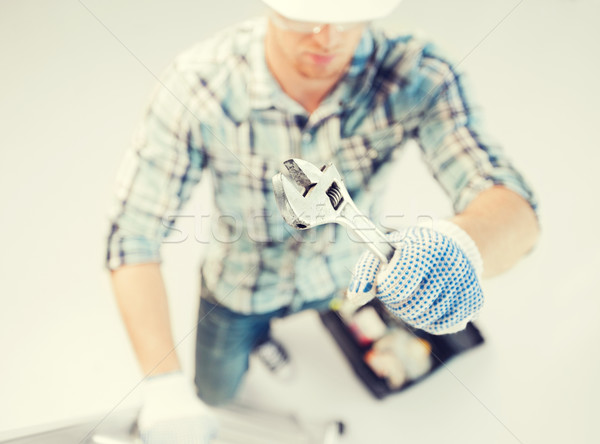 man with ladder, toolkit and spanner Stock photo © dolgachov