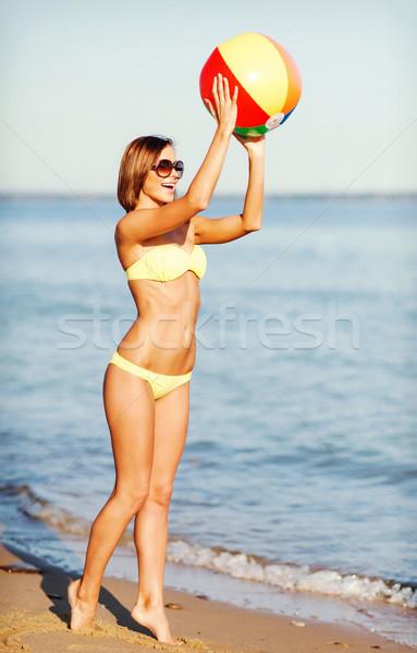 girl in bikini playing ball on the beach Stock photo © dolgachov