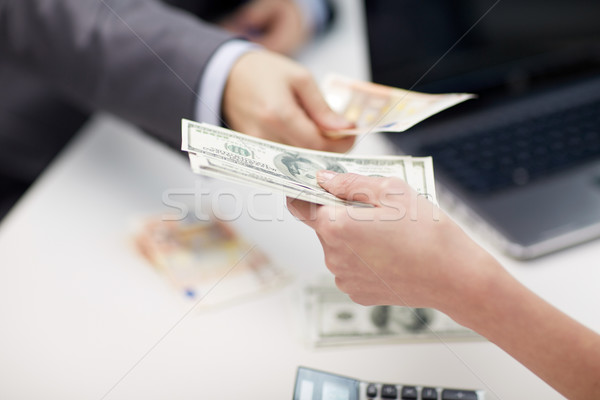close up of hands giving or exchanging money Stock photo © dolgachov