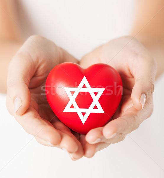 Homme mains coeur star religion Photo stock © dolgachov