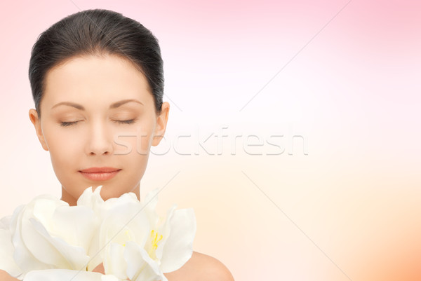 beautiful woman smelling flowers with closed eyes Stock photo © dolgachov