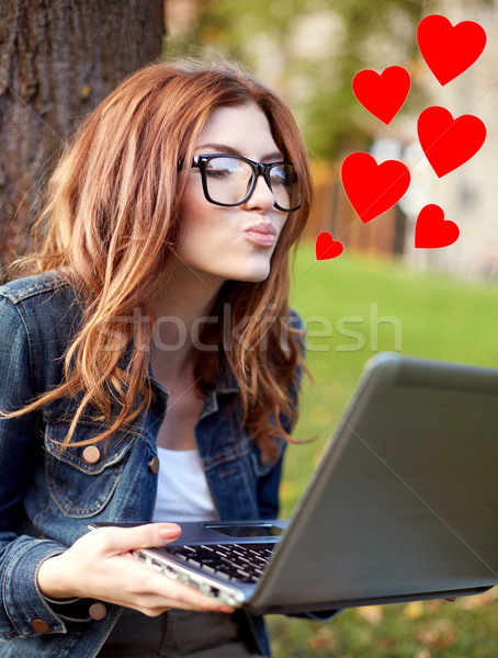 happy student girl writing to notebook at campus Stock photo © dolgachov