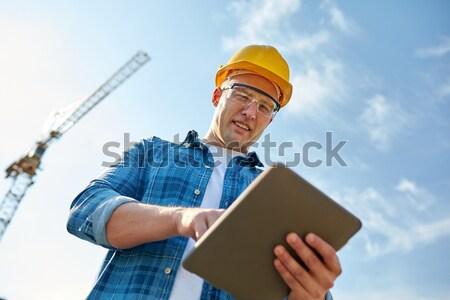 Közelkép építész munkavédelmi sisak táblagép üzlet épület Stock fotó © dolgachov