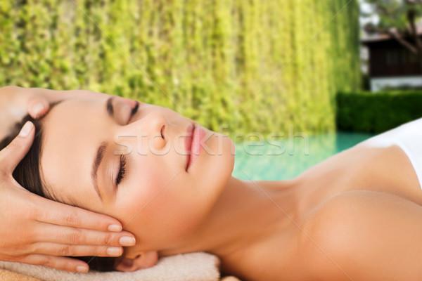 Stock photo: beautiful woman in spa salon having facial massage