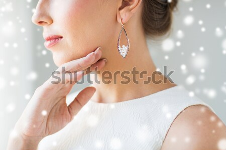 close up of woman wearing shiny diamond pendant Stock photo © dolgachov