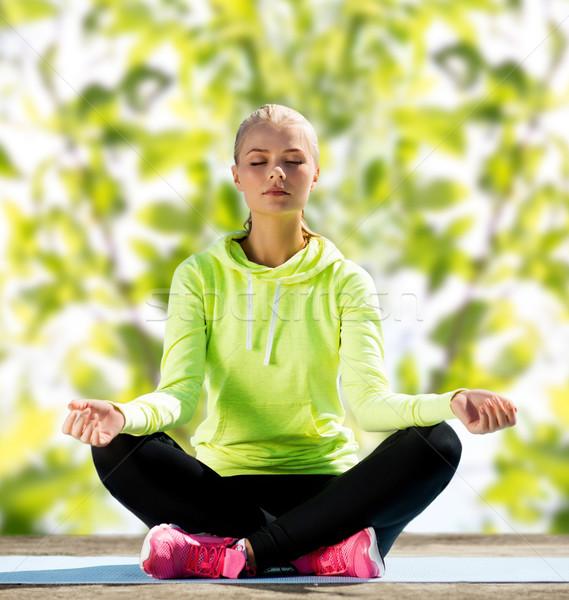 happy young woman doing yoga outdoors Stock photo © dolgachov