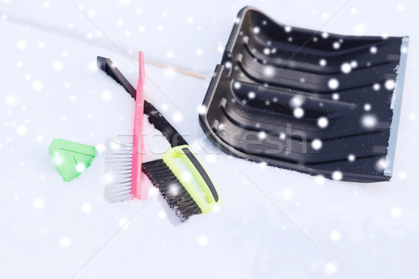 black snowshowel with wooden handle in snow pile Stock photo © dolgachov