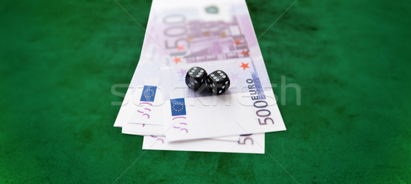 close up of black dice and euro cash money Stock photo © dolgachov