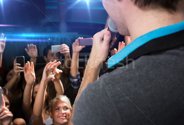 close up of happy people at concert in night club Stock photo © dolgachov