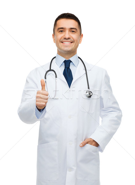 smiling doctor in white coat showing thumbs up Stock photo © dolgachov