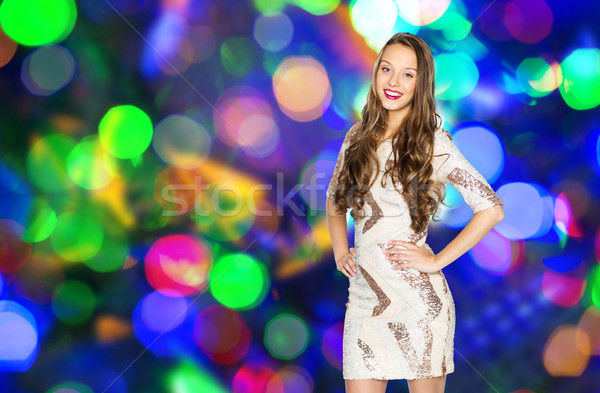 happy young woman or teen girl over disco lights Stock photo © dolgachov