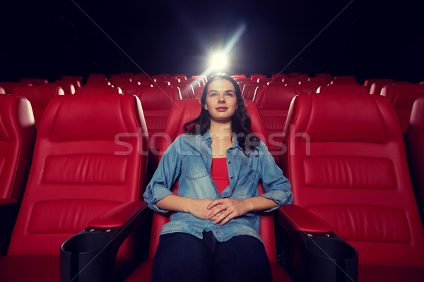 young woman watching movie in theater Stock photo © dolgachov