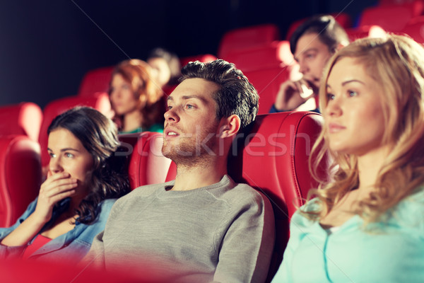 happy friends watching horror movie in theater Stock photo © dolgachov