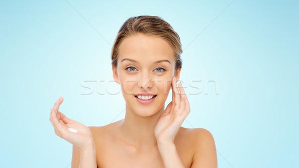 Feliz mulher jovem creme cara beleza Foto stock © dolgachov