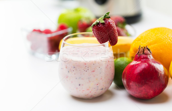 close up of glass with milk shake and fruits Stock photo © dolgachov
