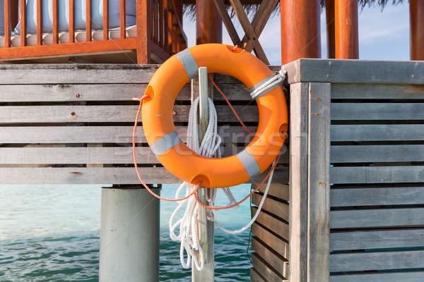 lifebuoy on beach patio or terrace in sea water Stock photo © dolgachov
