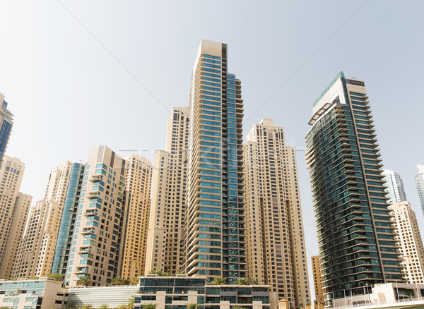 Dubai city business district with skyscrapers Stock photo © dolgachov