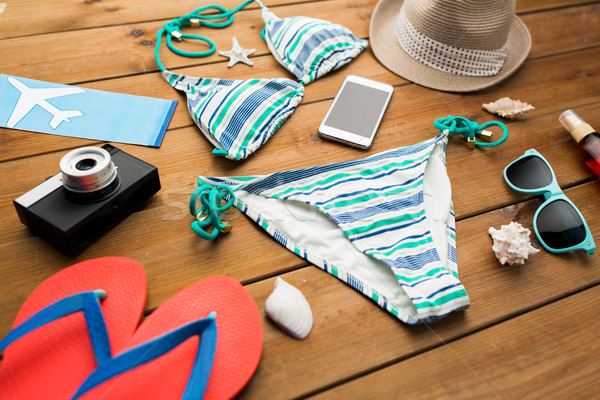 close up of smartphone and beach stuff Stock photo © dolgachov