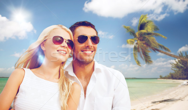 happy couple in sunglasses at maldives beach Stock photo © dolgachov