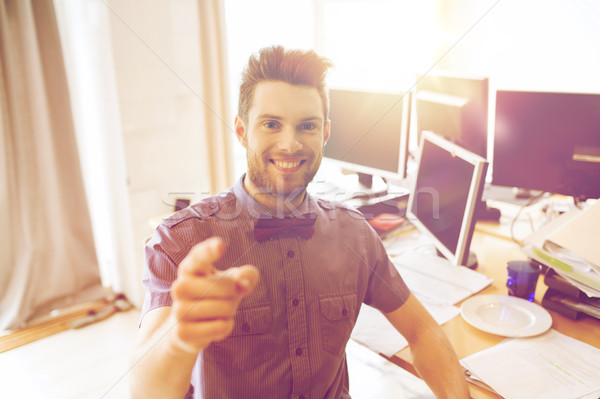 Stock photo: happy male office worker pointing finger at you