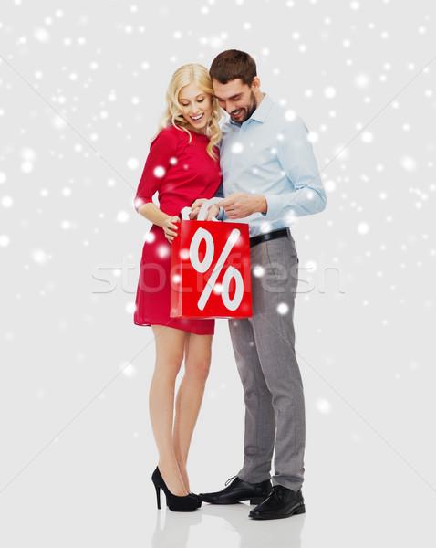 Boldog pár piros bevásárlószatyor hó emberek Stock fotó © dolgachov