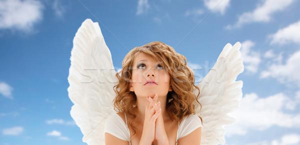 Praying Teenage Angel Girl Or Young Woman Stock Photo C Syda