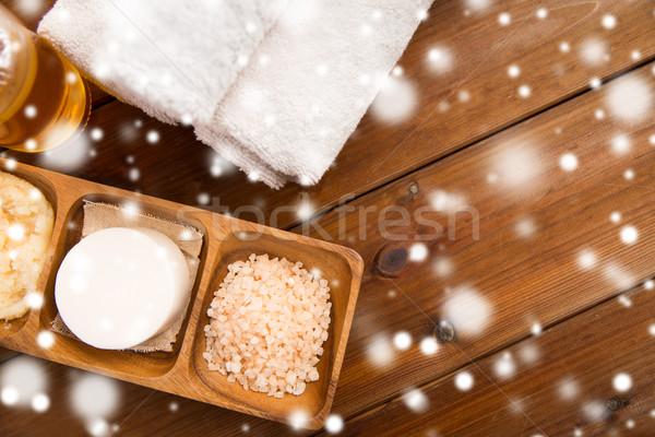 himalayan pink salt, soap bar and bath towels Stock photo © dolgachov