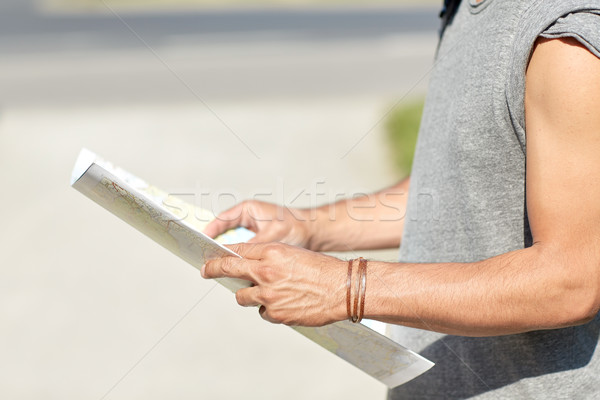 close up of man with travel map in city Stock photo © dolgachov