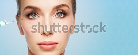 woman face and syringe making injection Stock photo © dolgachov