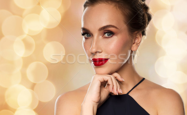 beautiful woman in black over dark background Stock photo © dolgachov