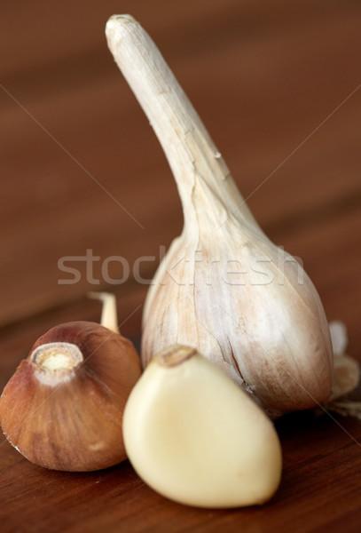 close up of garlic on wooden table Stock photo © dolgachov