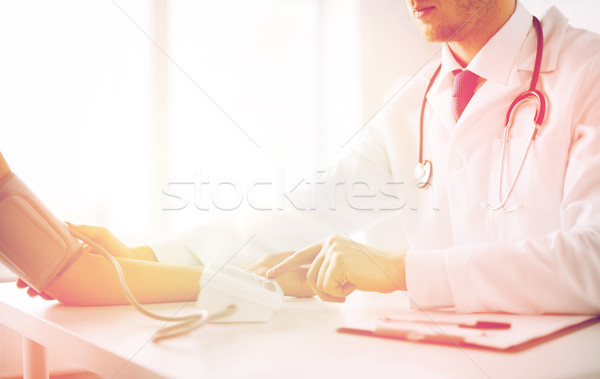doctor and patient measuring blood pressure Stock photo © dolgachov
