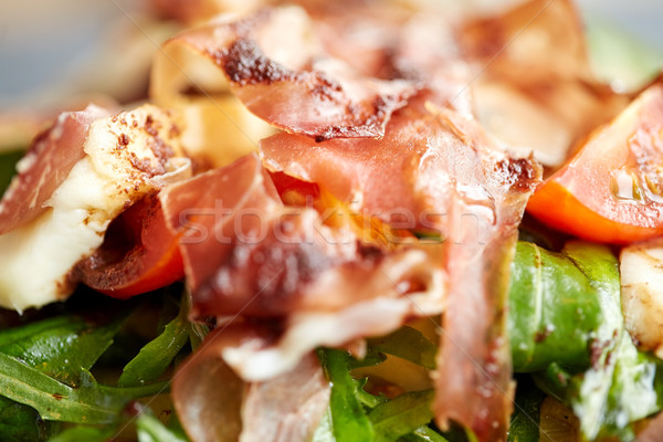 close up of prosciutto ham salad Stock photo © dolgachov