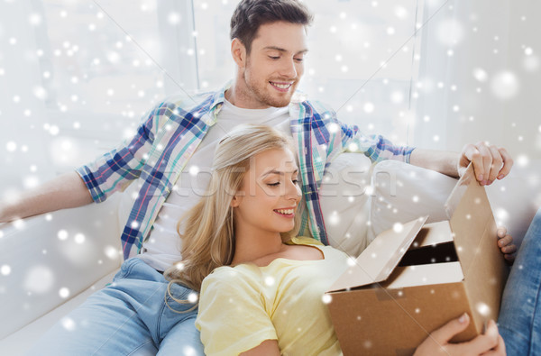 happy couple with cardboard box or parcel at home Stock photo © dolgachov