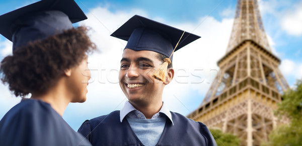 happy students or bachelors over eiffel tower Stock photo © dolgachov
