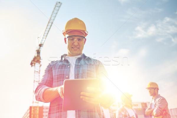 Constructor casco de seguridad construcción negocios edificio Foto stock © dolgachov